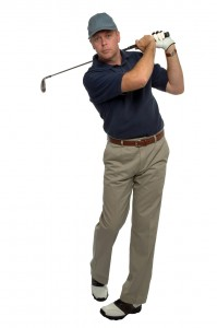 Golfer blue shirt iron shot
