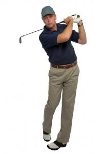 Golfer blue shirt iron shot